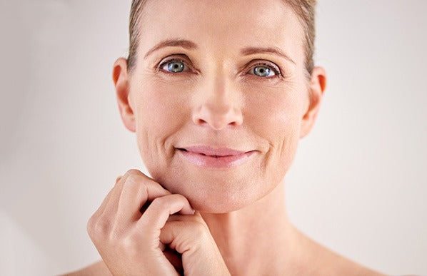 beautiful middle aged smiling woman with radiant facial skin
