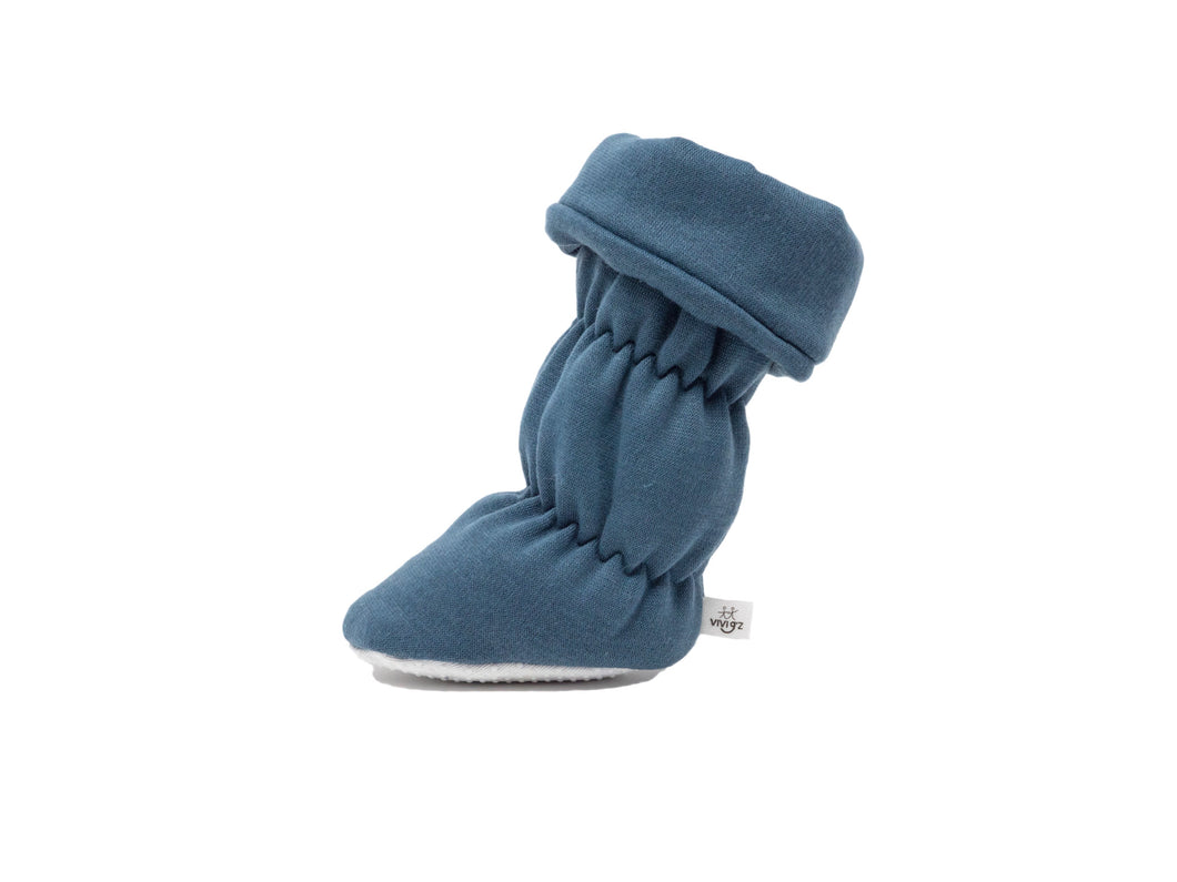"Vivi G'z signature classic ""Henry"" denim cuff belted baby booties are made of a soft cotton polyester fleece fabric and have a non slip grip sole – a staple in every baby's wardrobe for the fall/winter season."
