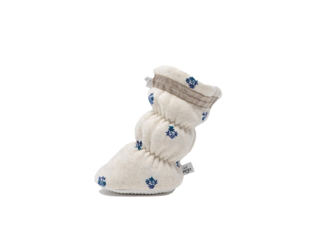 "Vivi G'z signature classic ""Ava"" oatmeal with ditsy floral print basic baby booties are made of a cotton polyester fleece fabric and have a non slip grip sole – a staple in every baby's wardrobe. Keep her feet warm and happy with a fun floral print."