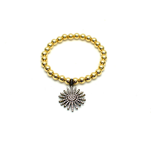 GOLD BEAD STRETCH BRACELET WITH DANGLING STARBURST