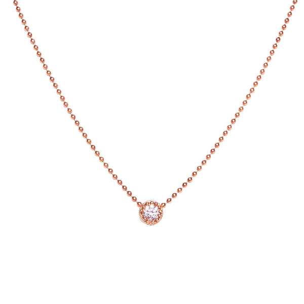 BRILLIANT CUT DIAMOND SET IN CUSTOM BEADED BEZEL, ROSE GOLD