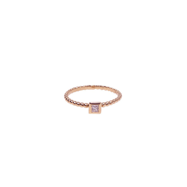 SINGLE BEZEL PRINCESS CUT DIAMOND ON 18K ROSE GOLD BEADED BAND