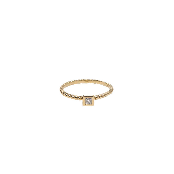 SINGLE BEZEL PRINCESS CUT DIAMOND ON 18K YELLOW GOLD BEADED BAND