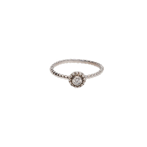 WHITE GOLD AND BEZEL SET DIAMOND SMALL BEADED DISC RING