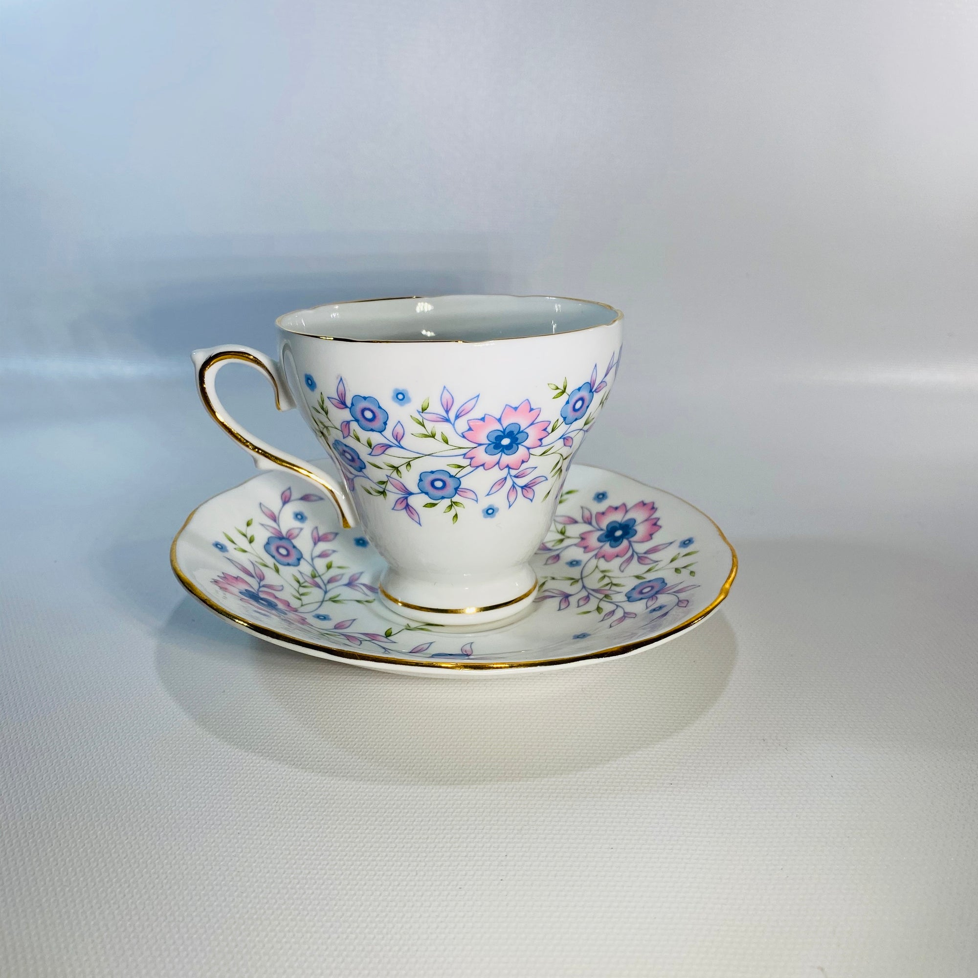 Blue Blossoms Avon Fine Bone China Teacup & Saucer Made  England 1974