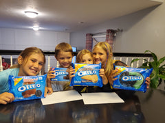 Kids with packs of Oreo Cookies {Daisy May & Me}