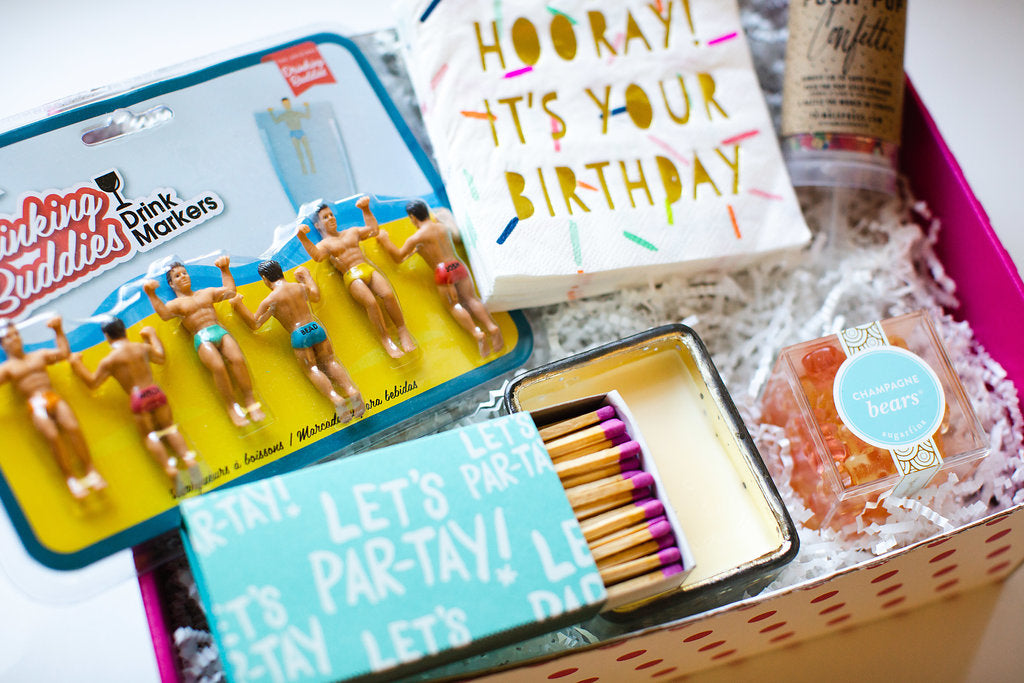 birthday box filled with drinking buddies, bears, champagne, candle, matches and more
