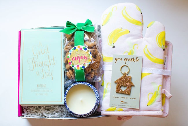 the perfect house warming gift! notepad, candle, oven kit and cookies