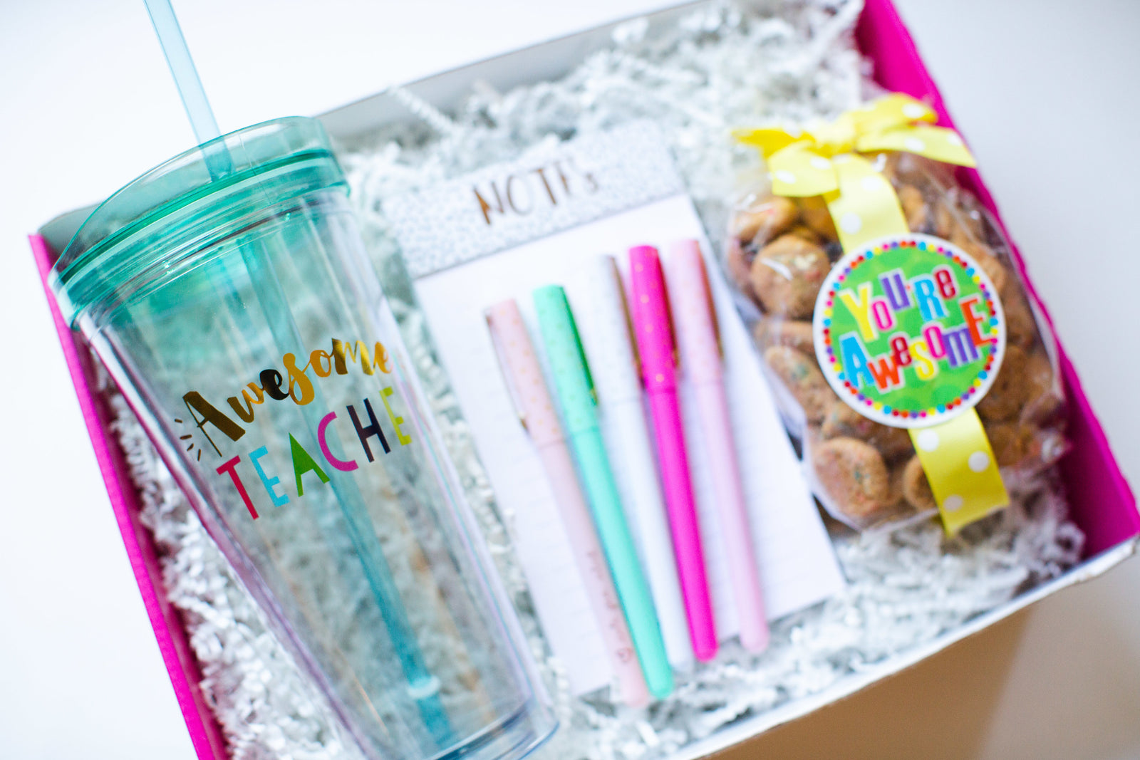awesome teacher deserves and awesome gift of cookies, pens and tumbler