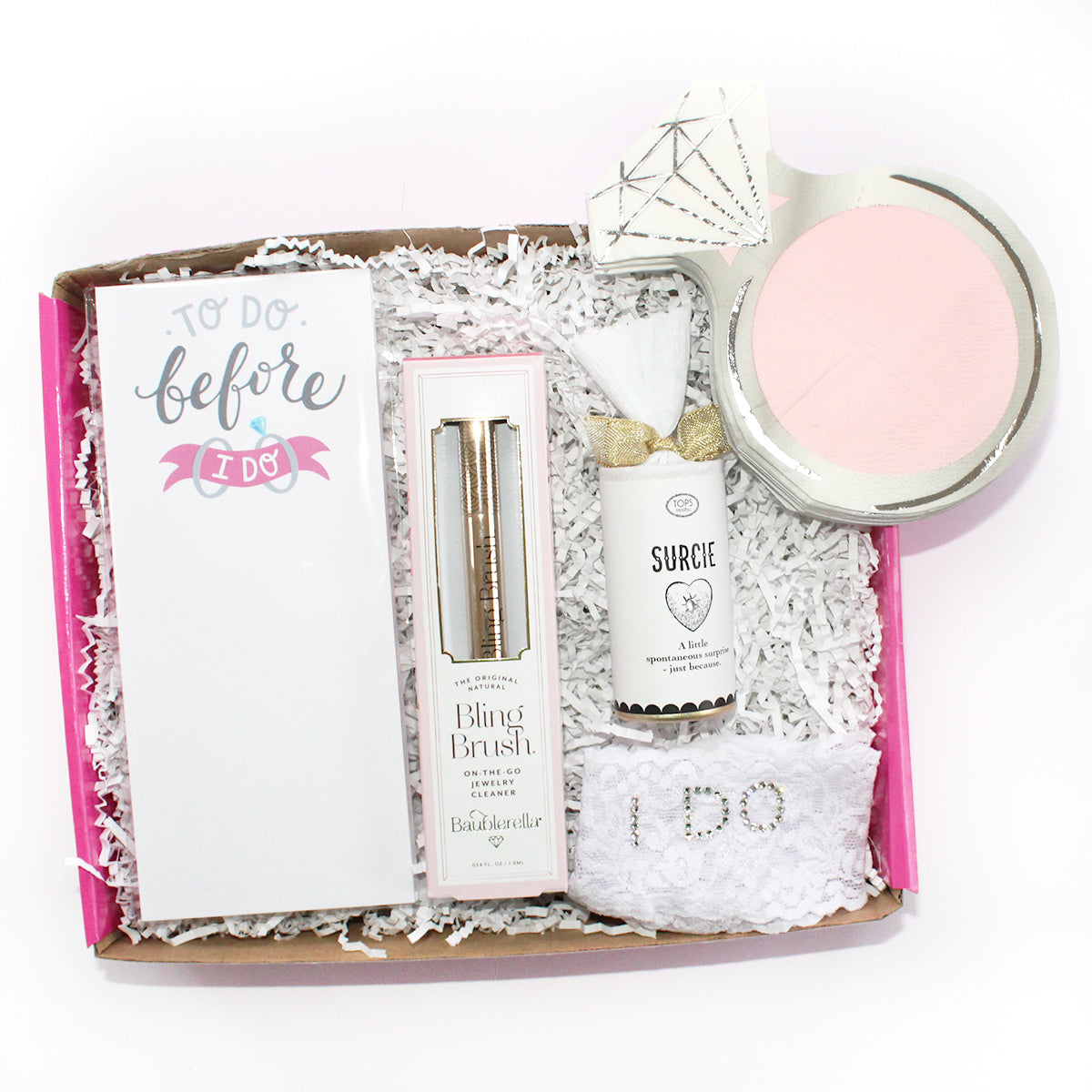 "the perfect bride box which includes a bling brush, surcie, ""I DO"" white hanky pankys, diamond ring napkins, and to do before I do notepad"