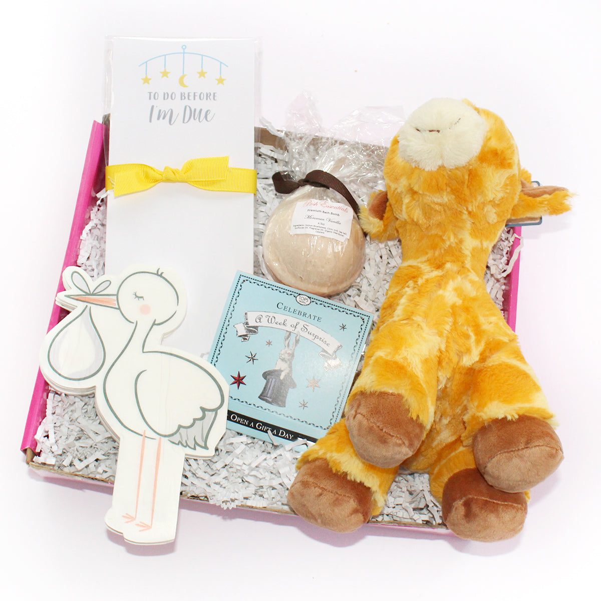 the new mommy to be includes stork napkins, giraffe, notepad, bath bomb, and surprises