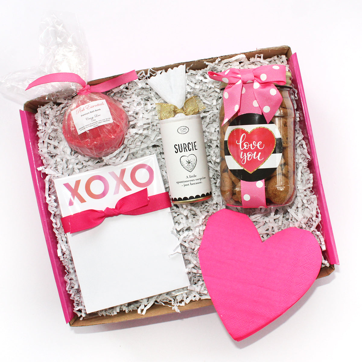 xoxo gift box for the love of your life which includes heart shaped napkins, chocolate chip cookies, surcie, xoxo notepad, bath bomb