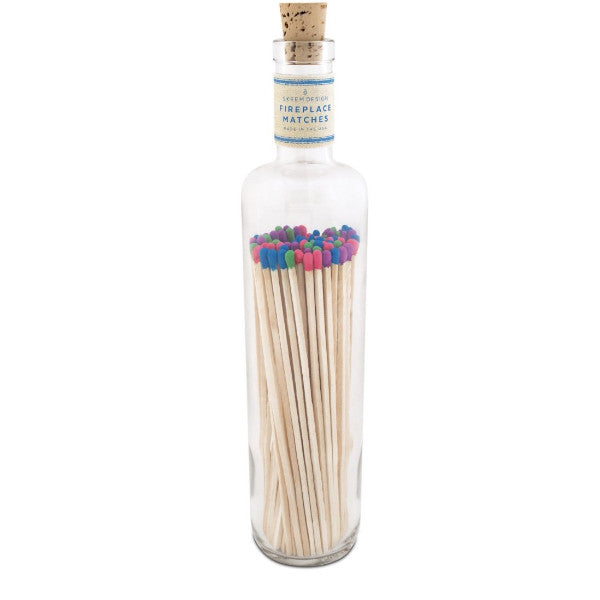 Multi-color fireplace matches in glass bottle with cork