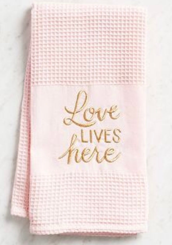 """Love lives here"" embroidered blush waffle kitchen tea towel"