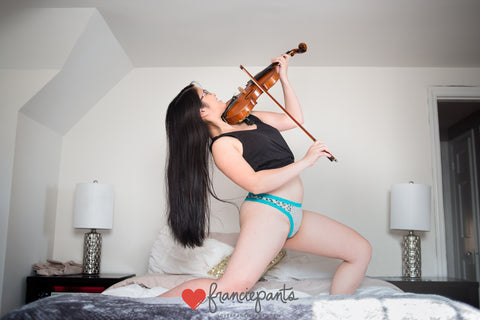 Woman playing violin in blue lace cotton underwear