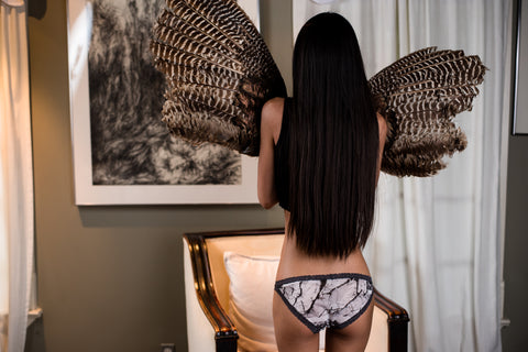 Woman holding bird wings and wearing FranciePants cotton panties