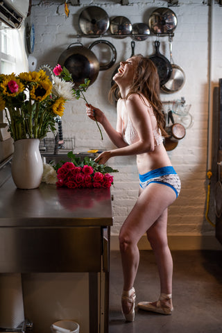 Ballerina in 100% cotton panties arranging flowers