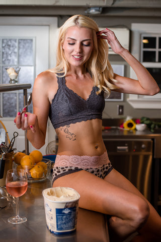 Model in FranciePants cotton underwear sitting on kitchen counter