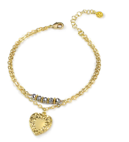 Gold heart bracelet with black diamond crystals