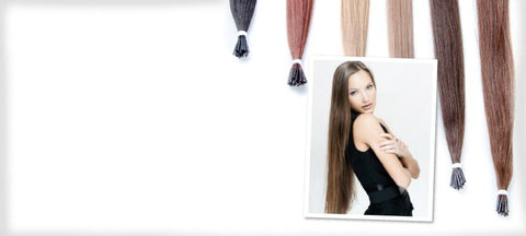 brunette model with long hair and strands of different colored microbead extensions