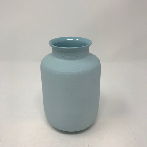 Delicate ceramic matte light blue vase with cinched neck and flared rim