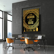 Office with motivational wall art of gold dreamcatcher.