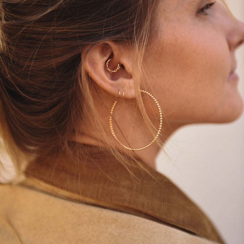 14k gold fill hoop earrings. sterling silver hoop earrings. Layering jewelry. agapantha jewelry. handmade in los angeles. stackable. modern, minimalist, everyday jewelry.