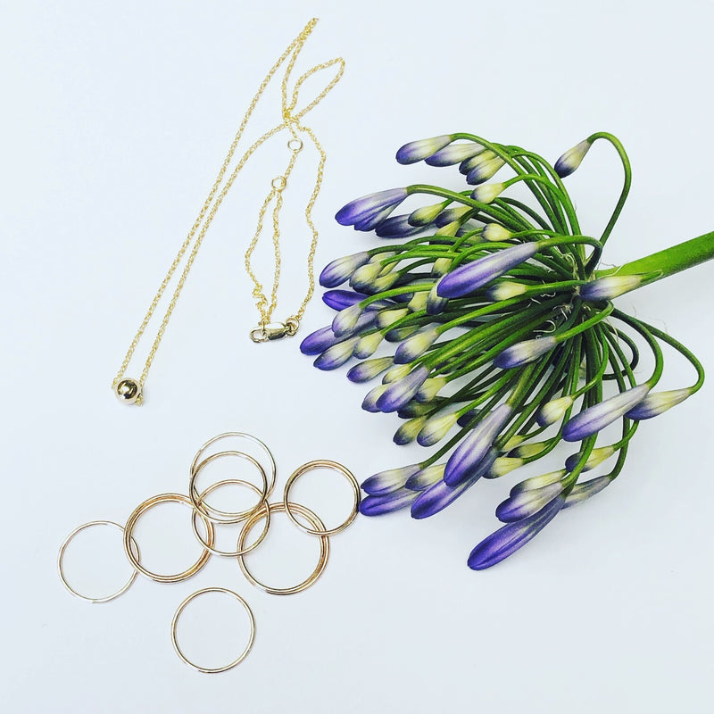 Handmade, delicate 14k gold filled jewelry. Dainty rings and layering necklaces.