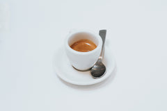 Espresso in white cup with spoon