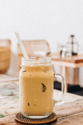 cold-brew coffee over ice with straw