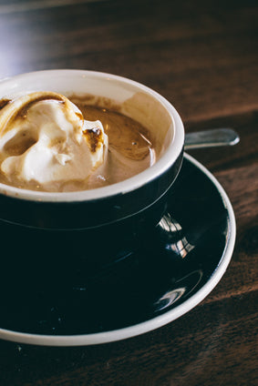 affogato in black and white cup with saucer