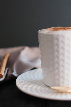 cinnamon cappuccino in a white ceramic cup