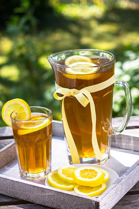 iced coffee lemonade in clear pitcher with lemon slices