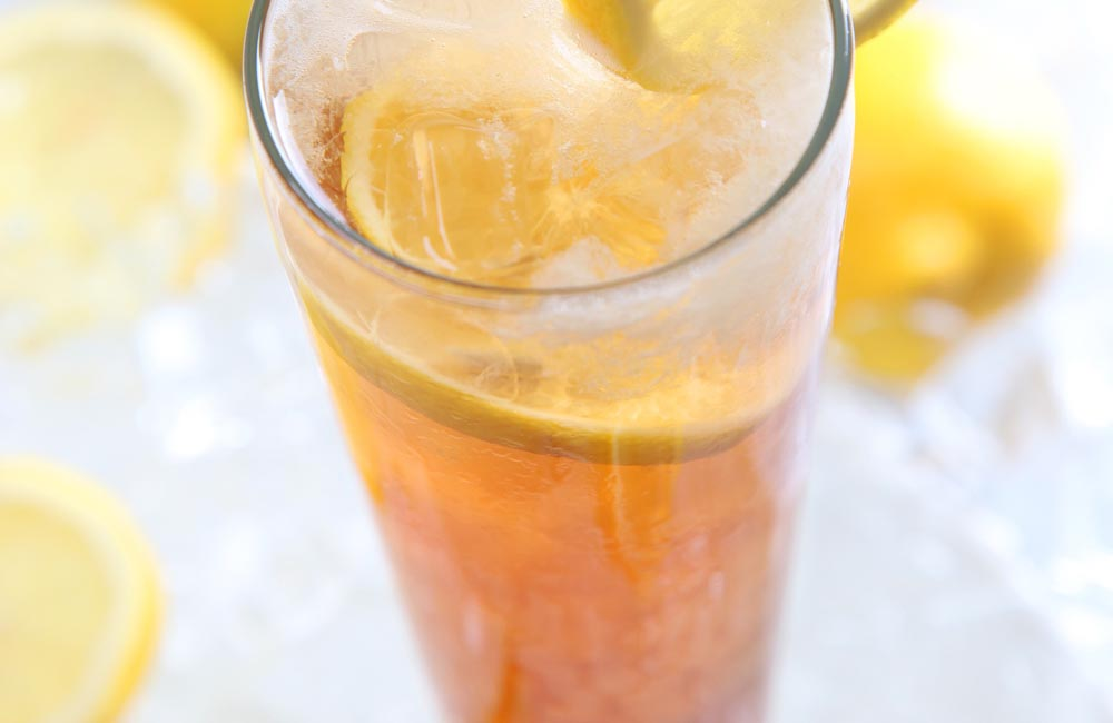 iced tea in clear glass with lemon slices