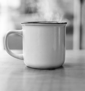 steaming coffee in a white porcelain coffee cup