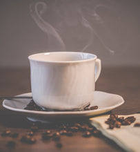 steaming coffee in white ceramic coffee cup