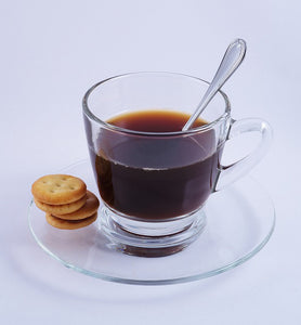 black coffee in clear glass coffee cup with spoon