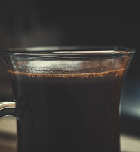 black coffee in a clear glass mug