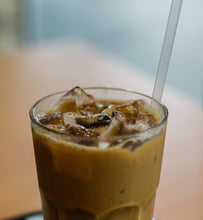 iced coffee in a clear glass with straw