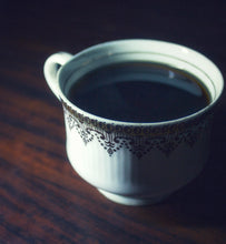 black coffee in a porcelain coffee cup