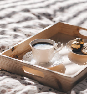 black coffee in white cup on breakfast tray