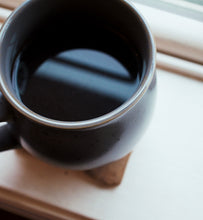 Township Park Blend in black coffee cup on window sill