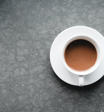 coffee in white cup on grey slate surface