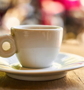 coffee in white mug on wooden table
