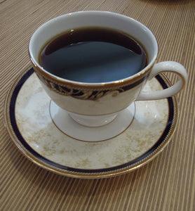black coffee in ornate porcelain coffee cup