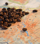 Ethiopian roasted coffee beans sit on map of Ethiopia
