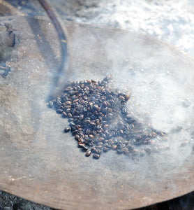 Ethiopian coffee is roasted during traditional coffee ceremony