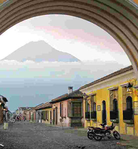guatemala antigua sits in shadow of Volcán de Fuego