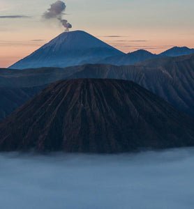 Sumatra volcanoes spewing ash at dusk