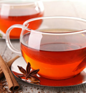 Cinnamon Plum Herbal in two clear glass teacups
